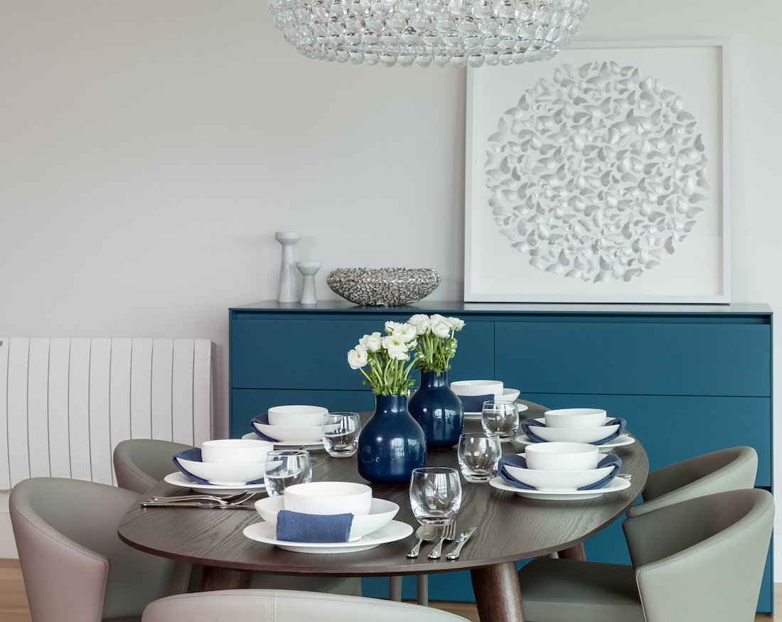 Dining table styling with neutrals, blues and foscarini pendant light. Residential Interiors