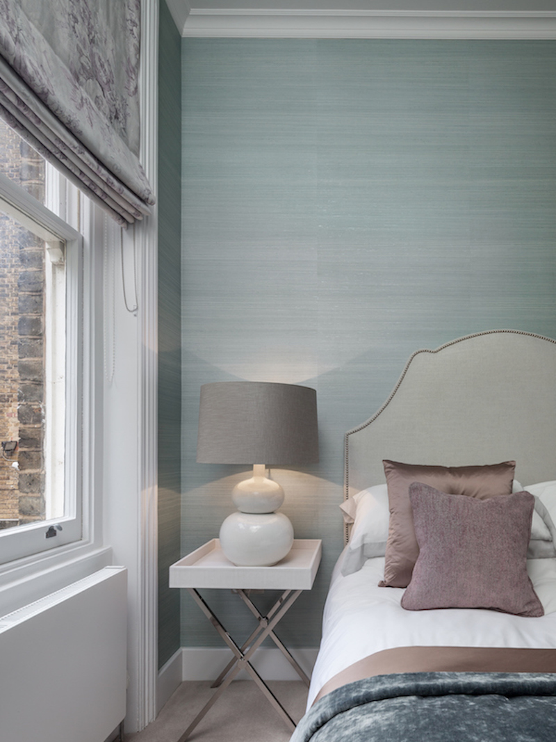 hotel chic guest bedroom with accents of green, lilac and cream